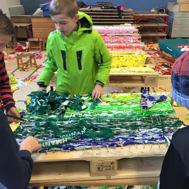 Kids making recycled plastic carpet 2