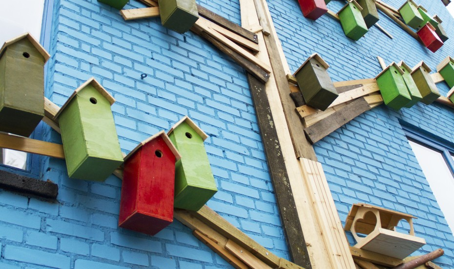 Close up of birdhouses on a mural