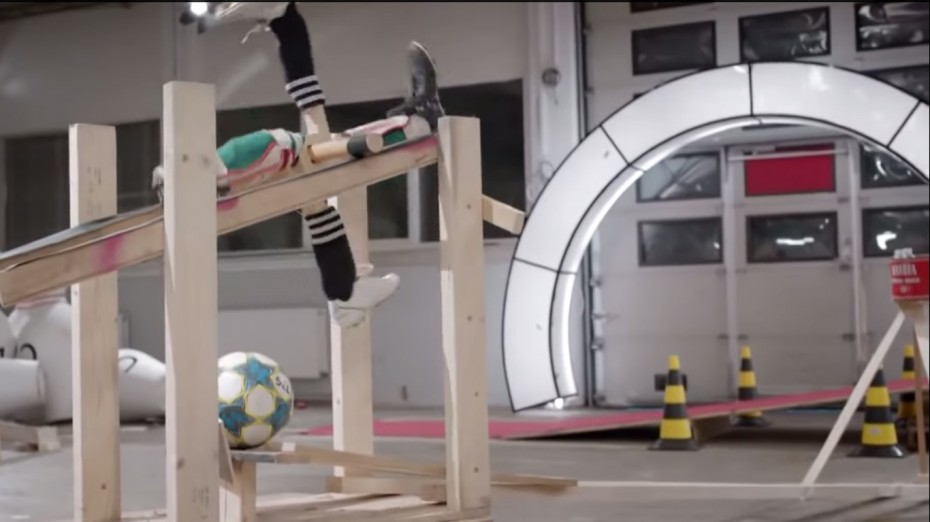 Foot kicking ball for recycled rube goldberg machine