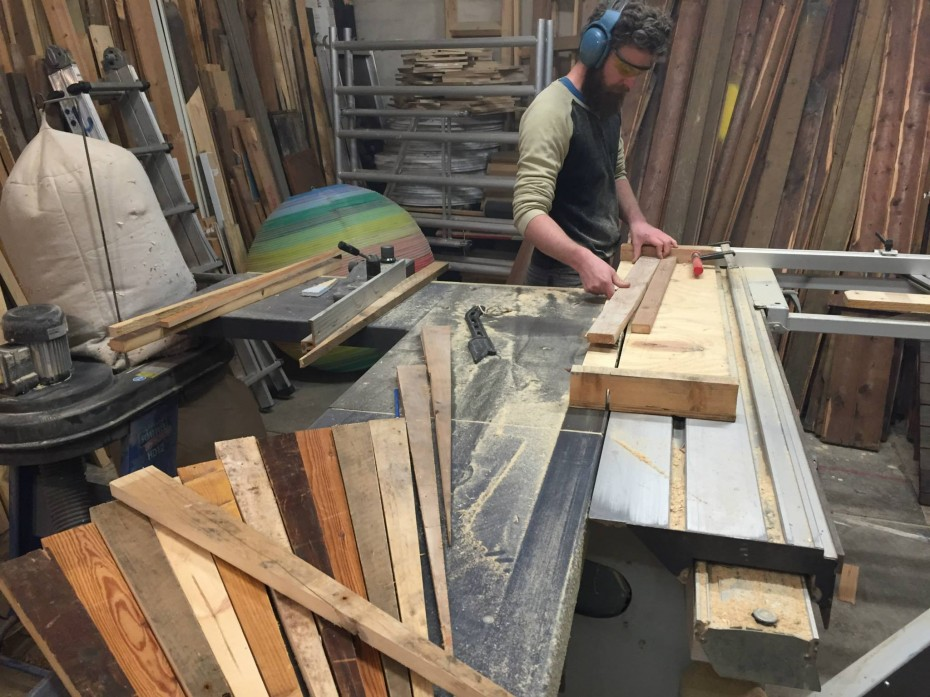 sawing wood for recycled peacock