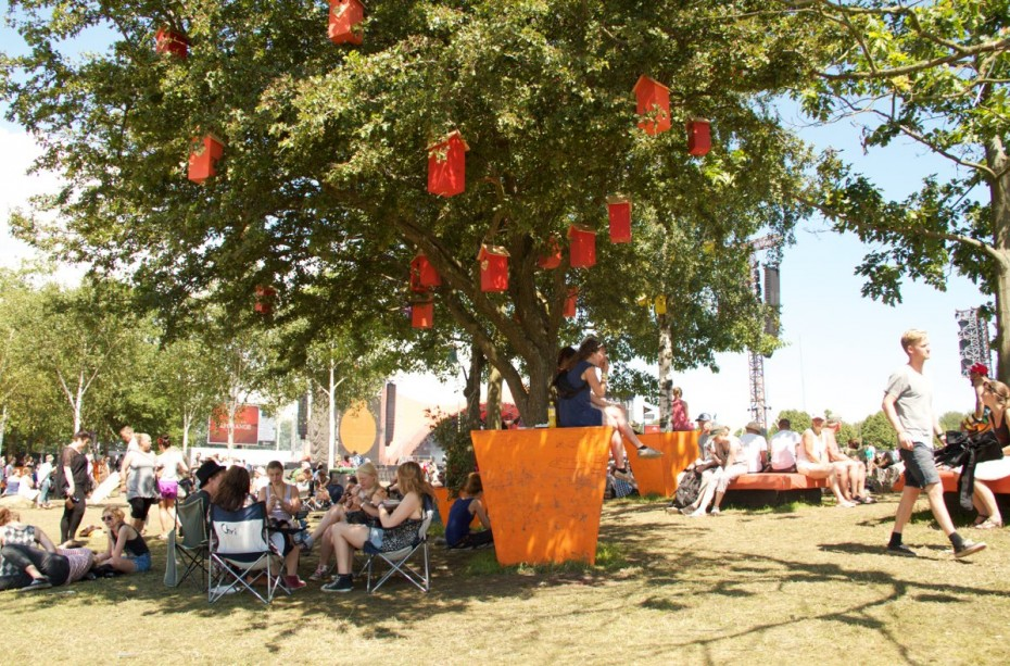 Recycled birdhouses in a tree at Roskilde Festival