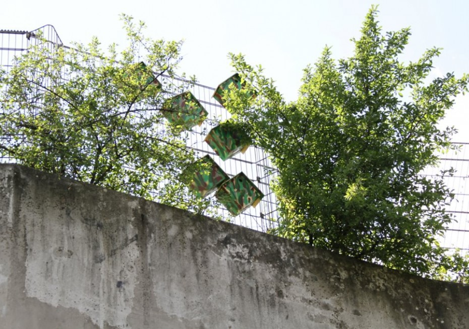 Camouflaged bird houses in a park in Berlin
