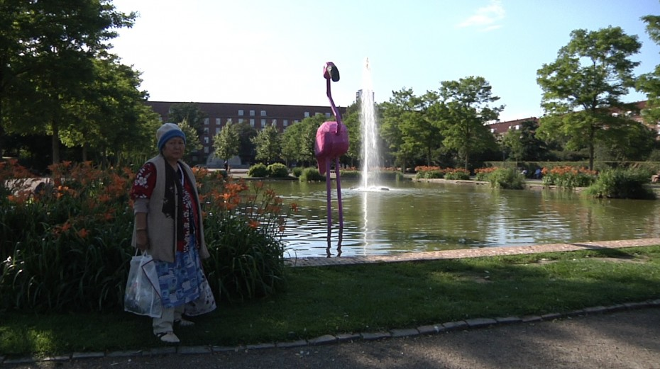Recycled flamingo sculpture with lady