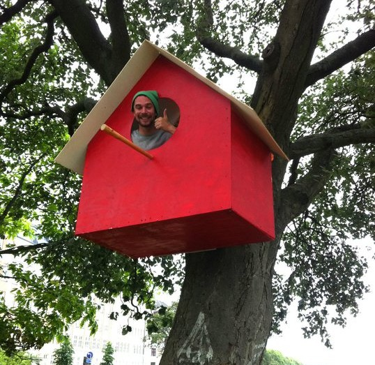 Human sized birdhouse made from recycled materials