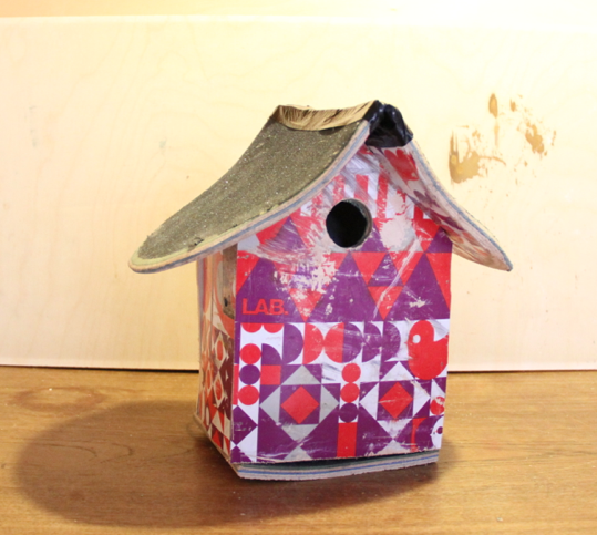 Upcycled birdhouse made from skateboards
