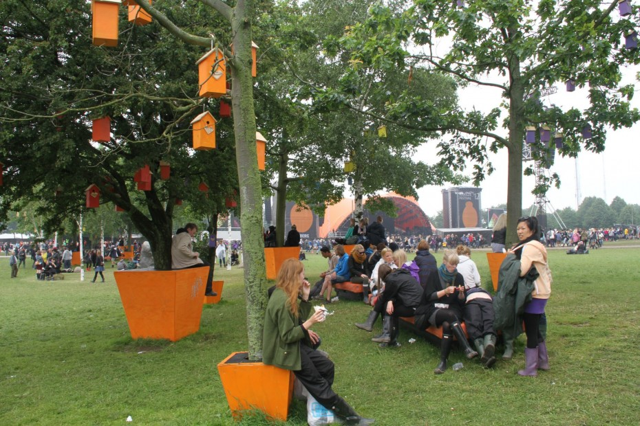 Girl hanging out under birdhouse tree at Roskilde Festival