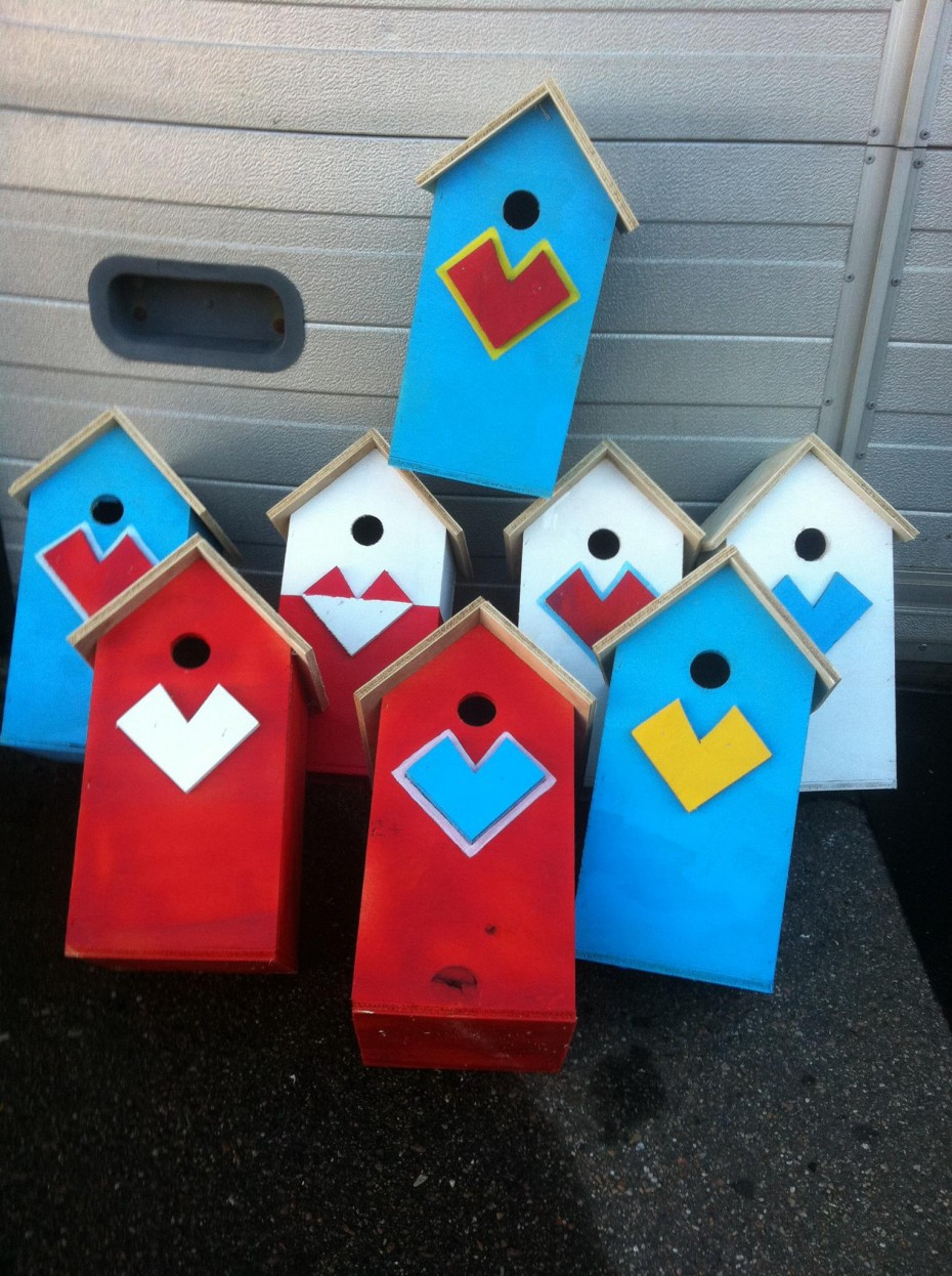 Recycled birdhouses in nordic colors